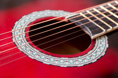 Part of red acoustic guitar. Close up Stock Photos