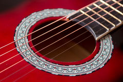 Part of red acoustic guitar. Close up Stock Image