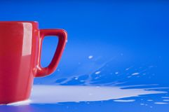 Part of red big cup with milk Stock Image