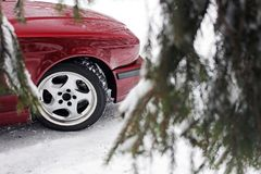 Part of a red car in the winter.  royalty free stock photos