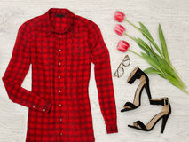 Part of a red checkered blouse, tulips, glasses, lipstick. Fashion concept, close up Stock Photography