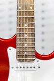 Part of red electric guitar with pickup. Close view of red electric guitar part with pickup Royalty Free Stock Photo
