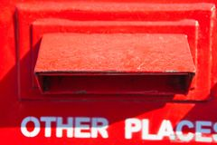 Part of the red mail box. Close up Stock Image