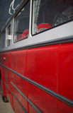 Part of red retro bus. Royalty Free Stock Photos