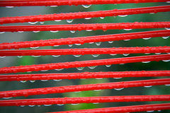 Part of red summer chair with raindrops Stock Photo
