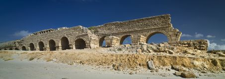 Part of the remains of the Herodian aqueduct near the ancient city of Caesarea, Israel. Panoramic view stock photo