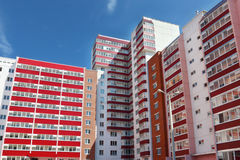 Part of residential building with many red loggias at summe. Part of pink residential building with many red loggias at summer day Stock Images