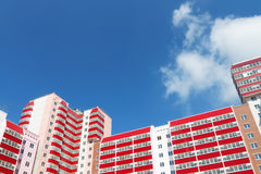 Part of residential building at sunny day, clouds Stock Images