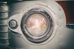 Part of retro style bus. Headlamp. Toned. Selective focus. Royalty Free Stock Photography