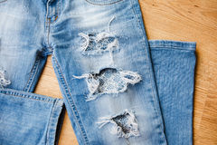 Part of ripped jeans Royalty Free Stock Photography