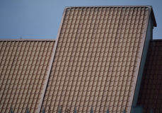 Part of the roof with beige tiles Royalty Free Stock Photos