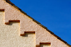 Part of the roof of the house against the  sky Royalty Free Stock Photo
