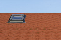 Part of the roof with sunroof. Part of the red roof with sunroof Royalty Free Stock Images