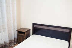 Part of a room with bed in a corner Royalty Free Stock Photo
