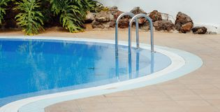 Part of round swimming pool with ladder. Closeup view Royalty Free Stock Image