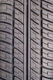 Part of rubber black car tire closeup Stock Image