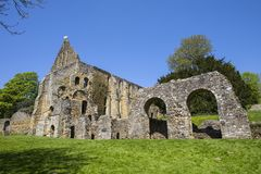 Ruins of Battle Abbey in East Sussex. Part of the ruins of the historic Battle Abbey in the town of Battle in East Sussex. The Abbey is located on the stock image