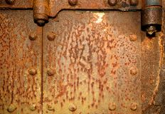 Part of rusty door. Close-up at rust on the old door Royalty Free Stock Photo