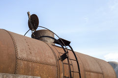 Part of rusty railway container with opened cap Stock Photo