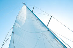 Part of sails. Piece of white sails against the blue sky Stock Photo
