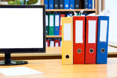 Part of the screen monitor isolated and colored folders for papers Royalty Free Stock Images