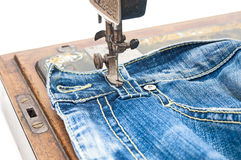 Part of sewing machine and jeans cloth Stock Photography