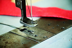 Part of sewing machine and red fabric close up. horizontal Stock Images