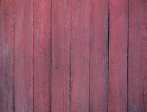 Part of shed built of vertical red painted planks Stock Photos