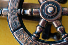 Part of a ship steering wheel. Part of the ship`s iron helm Stock Photo