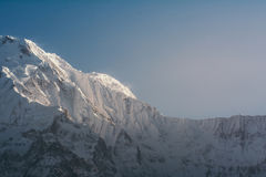 Part of snow mountain peak with sunlight. Part of Annapurna south mountain peak in the morning with sunlight Royalty Free Stock Photography