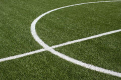 Part of a soccer field with green synthetic grass  Royalty Free Stock Image