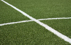 Part of a soccer field with green synthetic grass Stock Image