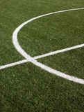 Part of a soccer field with green synthetic grass Royalty Free Stock Images