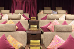 Part of soft sofas with cushions in cinema theatre. Royalty Free Stock Photos