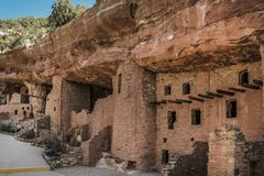 Open Cliff Dwellings. Part of some Cliff Dwellings. Liked how the sun was hidden behind the backside of the mountain. And very few people in the way. Taken near Royalty Free Stock Photography