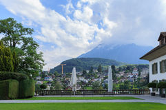 Part of Spiez. Beautiful park, part of old castle, blue summer sky and city view. City of Spiez, canton Bern, Switzerland Royalty Free Stock Photos