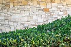 Part stone structure on a lawn Stock Photo