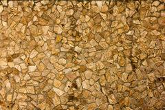 Part of a stone wall, brownish beige tones for background or texture. Royalty Free Stock Photography
