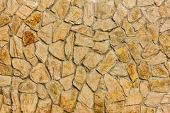 Part of a stone wall, brownish beige tones for background or texture. Royalty Free Stock Images