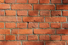 Part of a stone wall with red bricks Royalty Free Stock Photo
