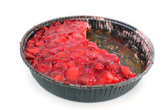 Part strawberry flan with cut pieces Stock Image