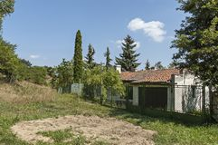 Part of street in the Paunovo village with old house, tree and fence, Sredna Gora mountain. Ihtiman, Bulgaria, Europe royalty free stock images