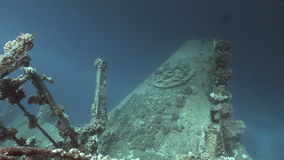 Part of a sunken ship Salem Express underwater in the Red Sea in Egypt. Extreme tourism on ocean floor in world of coral reefs, fish, sharks. Researchers of stock footage
