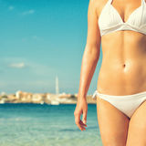 Part of suntanned woman body. Royalty Free Stock Photo