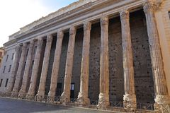 Part of a surviving wall on the Temple of Hadrian in Rome  Royalty Free Stock Images