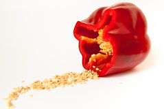 Part of sweet pepper isolated with seeds on white background. Part of sweet red pepper isolated with seeds on white background Stock Photo