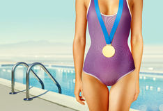 Part of swimmer with gold medal Royalty Free Stock Photography