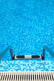 Part of swimming pool with ladder Royalty Free Stock Photo