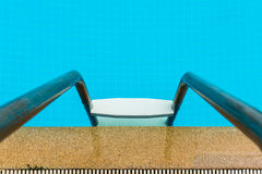 Part of swimming pool with ladder Royalty Free Stock Image