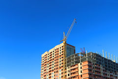 Part of tall crane and building under construction Stock Image